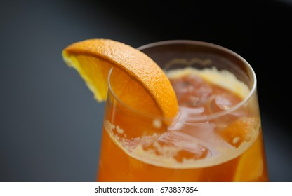 Enjoy refreshing tequila sunrise long drink in the bar.Juicy cocktails for party.Crystal glass with orange juice & booze.Hot drinks for adult people.Orange slice on glass