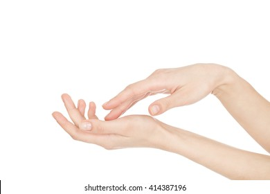 Enjoy the skin. Close up cropped shot of beautiful hands of a female isolated on white copyspace on the side.
