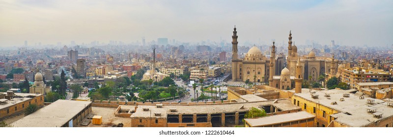 Enjoy the skyline of Islamic Cairo from the Saladin Citadel with a view on tall minarets of Sultan Hassan and Al-Rifa'i historic mosques, Egypt.