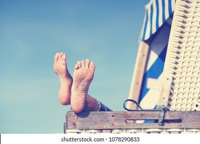 enjoy summer day at baltic sea in beach chair