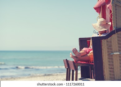 enjoy summer day at baltic sea in beach chair