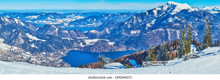 Enjoy winter vacation in Salzkammergut, famous for the best Alpine landscapes, nice ski areas and pure lakes, such the Wolfgangsee, seen from the snowy peak of Zwolferhorn mount, St Gilgen, Austria