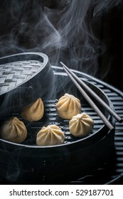 Enjoy your chinese dumplings in wooden steamer