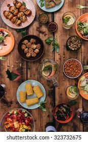 Enjoy your dinner! Top view of food and drinks on the rustic wooden table