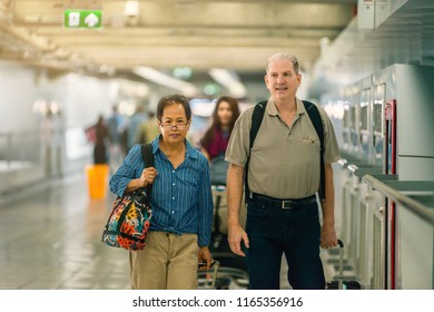 Enjoy your life. Portrait of elegant aged man and woman are standing together at international airport.