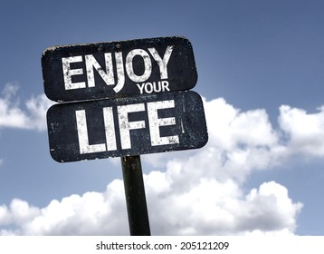 Enjoy your Life sign with clouds and sky background