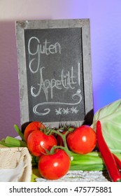 Enjoy your meal - blackboard - tomato