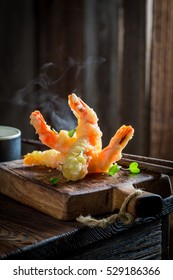 Enjoy your shrimp in tempura with red sauce
