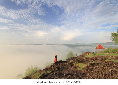 Enjoying beautiful morning with view of fog at Black Mountain, Gunungkidul, Yogyakarta, Indonesia