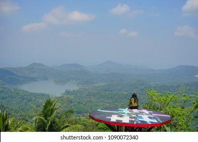 Enjoying beautiful view of Pule Payung in Menoreh hill, Yogyakarta, Indonesia
