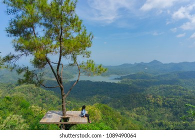Enjoying beautiful view of Sermo Reservoir from Kalibiru Hill, Yogyakarta, Indonesia