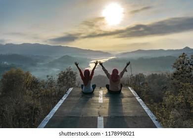 Enjoying beautiful view of sunset at Cendana Hill, Kulon Progo, Yogyakarta