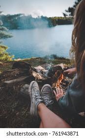 enjoying a campfire by the lake