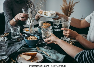 Enjoying cheese and wine at a dinner or celebration party with friends.