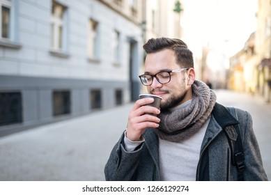 Enjoying coffee in the city street.