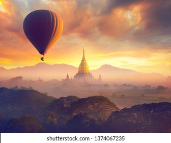 Enjoying colorful sunset over of Buddhist stupas and hot air balloon in the ancient Bagan. Myanmar, Asia.
