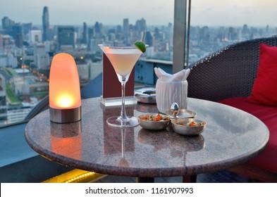 Enjoying a daiquiri at a rooftop bar of Bangkok
