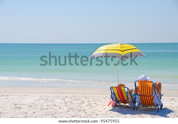 enjoying-day-beach-600w-95475955.jpg