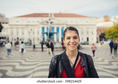 Enjoying Europe capital travel.Young traveler woman admiring beautiful Rossio square in Lisbon,Portugal.Energetic,dynamic day in cobblestoned Lisbon center streets.Travel blogger experiencing amazing