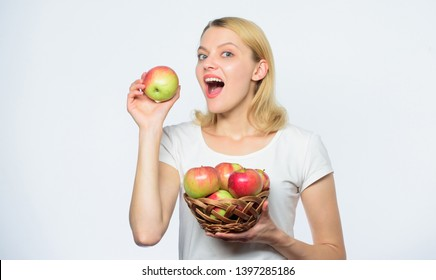 Enjoying healthy eating. vitamin diet and food shooping. farming concept. healthy teeth. autumn harvest. Spring seasonal fruit. Happy woman eating apple. orchard, gardener girl with apple basket.