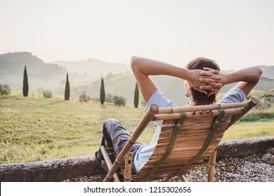 Enjoying life. Young man looking at the valley in Italy, relaxation, vacations, lifestyle concept