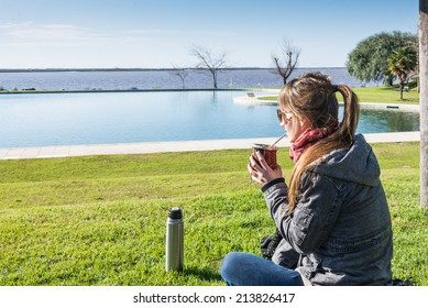 Enjoying Mate drink looking at the river. Buenos Aires. Argentina.