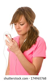 Enjoying Music On Smart Phone - This is a photo of a cute young woman ready to listen to some music on her ipod. Shot on an isolated white background with a shallow depth of field.