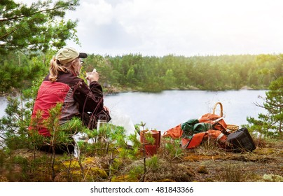 Enjoying the nature. Woman sits and are viewing the beautiful landscape.