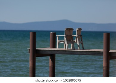 enjoying peace and time together by the lake at two chairs on a pier to the water in summer perfect for relaxation,  meditation and prevent burnout