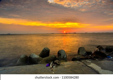 Enjoying peaceful and quiet sunset for meditation and relaxing at Pantai Mutiara seashoe oceanfront, Jakarta