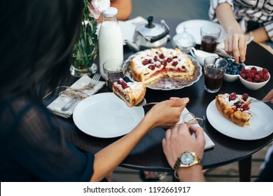 Enjoying pie with friends. Group of people having breakfast together. food, eating and family concept