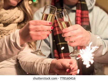 Enjoying a romantic holiday moment with champagne and sparklers