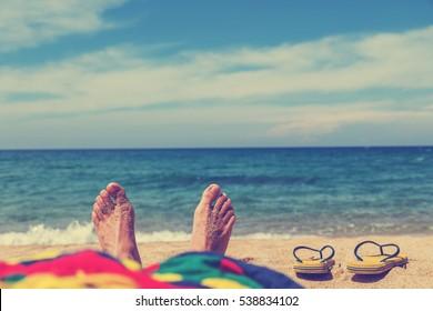 Enjoying the sea / ocean. Focus is on the feet.