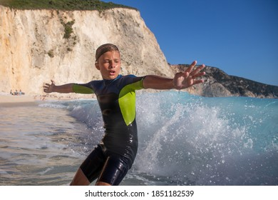 Enjoying summer and having great fun with big waves on an idyllic beach in Mediteranean