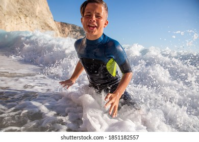 Enjoying summer and having great fun with big waves on an idyllic beach in Mediteranean