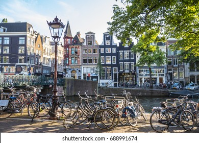 Enjoying the sun along the canals in Amsterdam - AMSTERDAM / THE NETHERLANDS - JULY 20, 2017