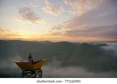 Enjoying sunrise and misty morning at Panguk Hill, Bantul, Yogyakarta, Indonesia