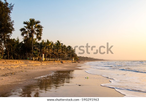 Enjoying the sunset on an idyllic beach in the Gambia, West Africa