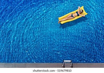 Enjoying Suntan Vacation Concept Top View Of Slim Young Woman In Bikini On The