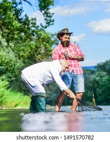 Enjoying time together. fly fish hobby of businessman. retirement fishery. Two male friends fishing together. Catching and fishing. happy fishermen friendship. retired dad and mature bearded son.
