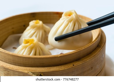 Enjoying traditional Shanghai dumpling, also called xiaolongbao