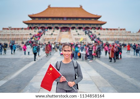 8dae2822e6 Enjoying vacation in China. Traveling young woman with national chinese in  Forbidden City