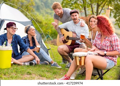 Enjoyment of youth in front of tent in camp in nature