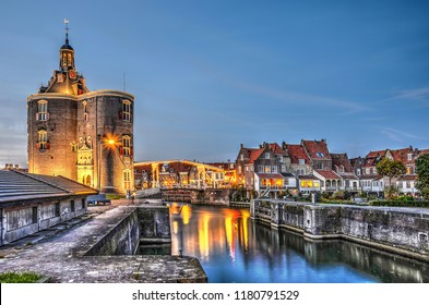 Enkhuizen, The Netherlands, October 26, 2015: Nocturnal view of Dromedaris gate, the drawbridge across the Old Harbour and the traditional houses on the other side.