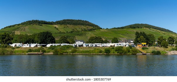 Enkirch, Rheinland-Pfalz / Germany - 31 July 2020: view of the idyllic RV and caravan park in Enkirch on the Mosel River