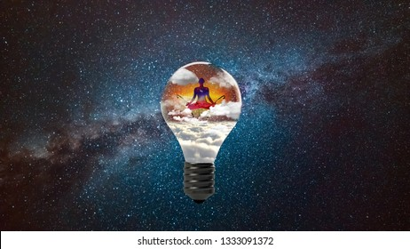 Enlightenment meditation buddha silhouette inside a light bulb with clouds and the galaxy