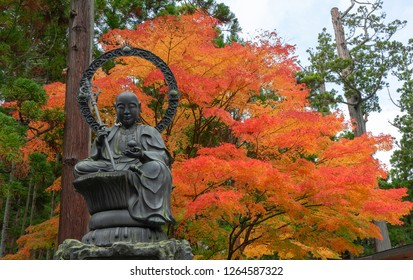 Enmei Jizo bronze statue at Zuigan-ji Temple with autumn maple leaves in autumn Matsushima, Japan. Zuiganji is one of the Tohoku Region most famous and prominent Zen temples.