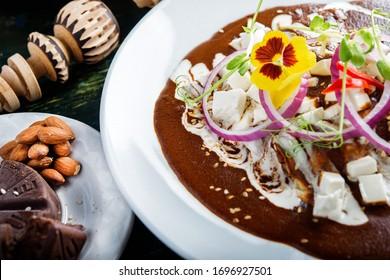 enmoladas, traditional mexican food dish, mole negro oaxaca