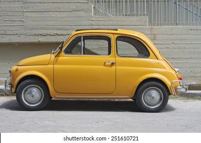 ENNA, ITALY - APRIL 19 - an old Fiat 500 parked in the City of Enna. It is a city car produced by the Italian manufacturer Fiat between 1957 and 1975. Shown on April 19, 2014 in Enna, Italy.