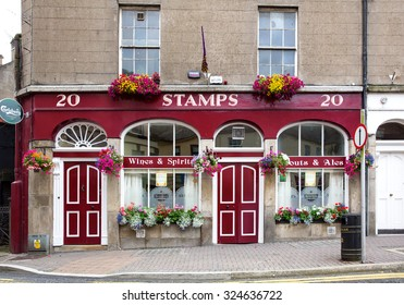 ENNISCORTHY, IRELAND - AUGUST 16, 2015: Stamps public house. It is a quaint Irish pub built in 1844 fronted with a concrete brick cobbled footpath.